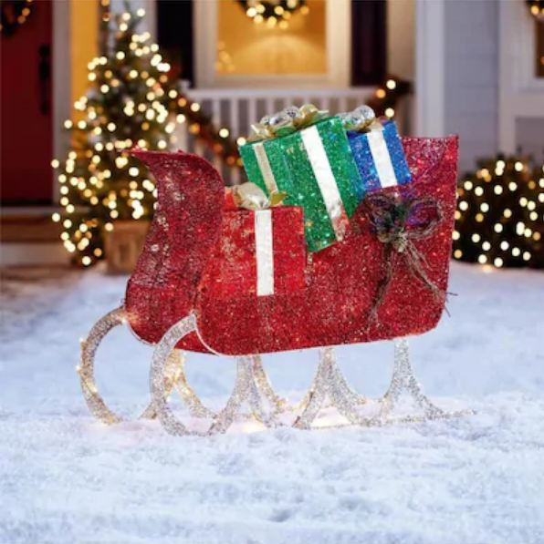 lighted sleigh sculpture with gift  boxes